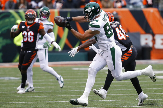 New York Jets tight end Ryan Griffin (84) misses a pass against Cincinnati Bengals defensive back Brandon Wilson, right, during the first half of an NFL football game, Sunday, Dec. 1, 2019, in Cincinnati. (AP Photo/Frank Victores)
