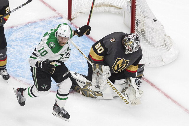 Dallas Stars' Corey Perry (10) reacts as the puck goes in past Vegas Golden Knights goalie Robin Lehner (90) on a goal by Denis Gurianov during overtime NHL Western Conference final playoff game action in Edmonton, Alberta, Monday, Sept. 14, 2020. (Jason Franson/The Canadian Press via AP)