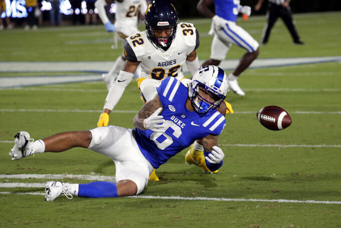 Duke wide receiver Eli Pancol (6) cannot haul in a pass as he is defended by North Carolina A&T defensive back Aaron Harris (32) during the first half of an NCAA college football game in Durham, N.C., Friday, Sept. 10, 2021. (AP Photo/Chris Seward)