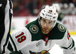 FILE  - In this Saturday, March 23, 2019, file photo, Minnesota Wild's Luke Kunin (19) waits for a face off during the first period of an NHL hockey game against the Carolina Hurricanes, in Raleigh, N.C. The Nashville Predators traded center Nick Bonino to the Minnesota Wild for forward Luke Kunin on Wednesday, Oct. 7, 2020, a swap on the second day of the NHL draft that sent two picks to the Wild and one back to the Predators.(AP Photo/Karl B DeBlaker, File)
