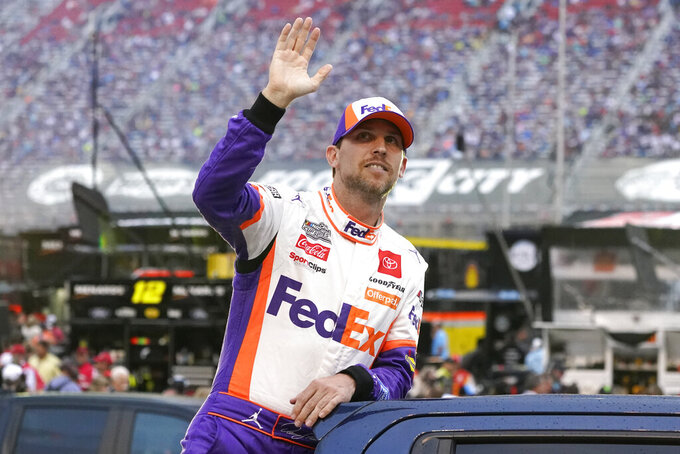 Denny Hamlin waves to fans as he is introduced before a NASCAR Cup Series auto race at Bristol Motor Speedway Saturday, Sept. 18, 2021, in Bristol, Tenn. (AP Photo/Mark Humphrey)