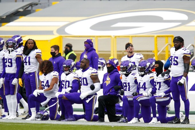 Minnesota Vikings players kneel during the national anthem before an NFL football game against the Green Bay Packers Sunday, Nov. 1, 2020, in Green Bay, Wis. (AP Photo/Matt Ludtke)