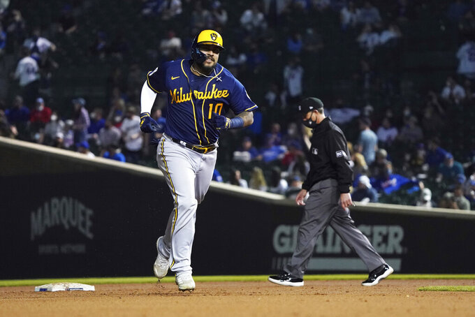 Milwaukee Brewers' Omar Narvaez runs the bases after hitting a three-run home run against the Chicago Cubs during the seventh inning of a baseball game, Monday, April 5, 2021, in Chicago. (AP Photo/David Banks)