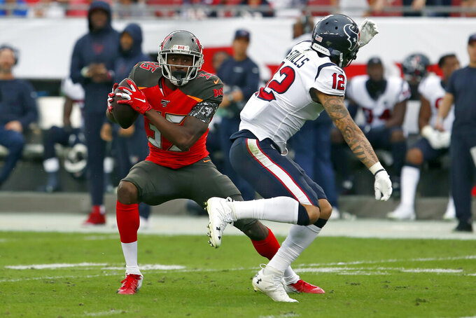 Tampa Bay Buccaneers defensive back Jamel Dean (35) intercepts a pass intended for Houston Texans wide receiver Kenny Stills (12) during the first half of an NFL football game Saturday, Dec. 21, 2019, in Tampa, Fla. (AP Photo/Mark LoMoglio)