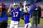 Buffalo Bills quarterback Josh Allen (17) laughs with wide receiver Stefon Diggs (14) before an NFL divisional round football game against the Baltimore Ravens Saturday, Jan. 16, 2021, in Orchard Park, N.Y. (AP Photo/Jeffrey T. Barnes)