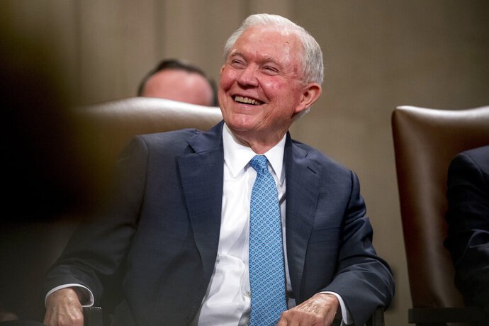 FILE - In this May 9, 2109, file photo, former Attorney General Jeff Sessions smiles during a farewell ceremony for Deputy Attorney General Rod Rosenstein in the Great Hall at the Department of Justice in Washington. Sessions is planning to run for his former Senate seat in Alabama. (AP Photo/Andrew Harnik, File)
