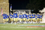 Tulsa Golden Hurricane offensive lineman Tiller Bucktrot (68) leads his teammates onto the field before their game against East Carolina in Tulsa. Okla. on Friday, Oct. 30, 2020.(Ian Maule/Tulsa World via AP)