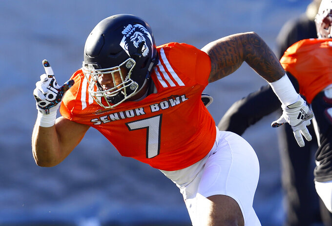 South defensive end Oshane Ximines of Old Dominion (7) runs drills during practice for Saturday's Senior Bowl college football game, Thursday, Jan. 24, 2019, in Mobile, Ala. (AP Photo/Butch Dill)