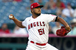 Los Angeles Angels starting pitcher Jaime Barria throws to the Texas Rangers during the first inning of a baseball game Monday, Sept. 6, 2021, in Anaheim, Calif. (AP Photo/Marcio Jose Sanchez)