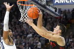 San Diego State forward Yanni Wetzell, right, passes the ball as Utah State forward Alphonso Anderson defends during the first half of an NCAA college basketball game Saturday, Jan. 4, 2020, in Logan, Utah. (AP Photo/Eli Lucero)