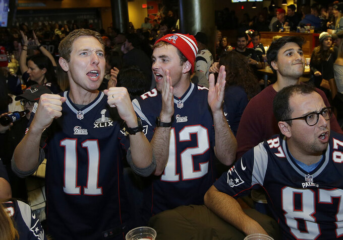 New England Patriots fans cheer at a bar in Boston while watching the first half of the NFL Super Bowl 53 football game in Atlanta between the Patriots and the Los Angeles Rams, Sunday, Feb. 3, 2019. (AP Photo/Steven Senne)