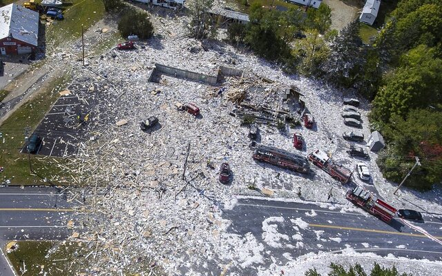 FILE - This Sept. 16, 2019, file photo shows an aerial view of the devastation after an explosion at the Life Enrichment Advancing People (LEAP) building, in Farmington, Maine. The blast killed one firefighter and injured multiple other people. (Russ Dillingham/Sun Journal via AP, File)