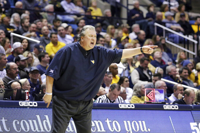West Virginia coach Bob Huggins reacts to a call during the second half of an NCAA college basketball game Wednesday, Feb. 5, 2020, in Morgantown, W.Va. (AP Photo/Kathleen Batten)