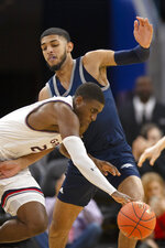 Saint Mary's forward Malik Fitts (24) drives around Nevada forward Robby Robinson during the first half of an NCAA college basketball game on Saturday, Dec. 21, 2019, in San Francisco. (AP Photo/D. Ross Cameron)