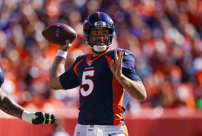 Denver Broncos quarterback Joe Flacco prepares to throw a pass during the first half of an NFL football game against the Tennessee Titans, Sunday, Oct. 13, 2019, in Denver. (AP Photo/Jack Dempsey)