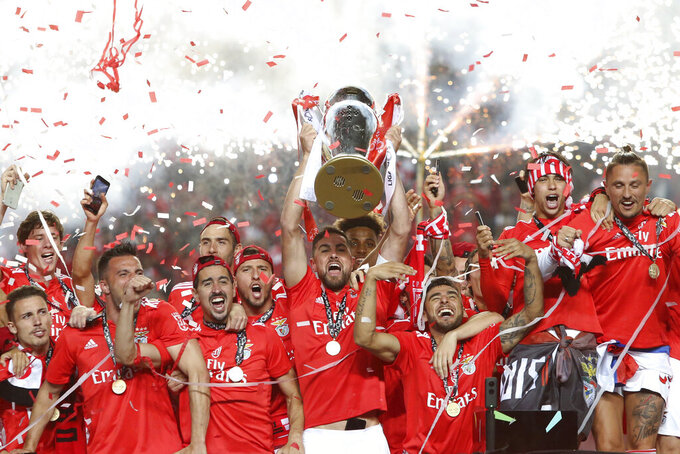 FILE - In this May 18, 2019 file photo, Benfica's team captain Jardel lifts the trophy after Benfica won the Portuguese league by beating Santa Clara in the last round soccer match at the Luz stadium in Lisbon. The Portuguese league will resume Wednesday, June 4, 2020 as European soccer continues to make its gradual return amid the coronavirus pandemic. (AP Photo/Armando Franca, File)