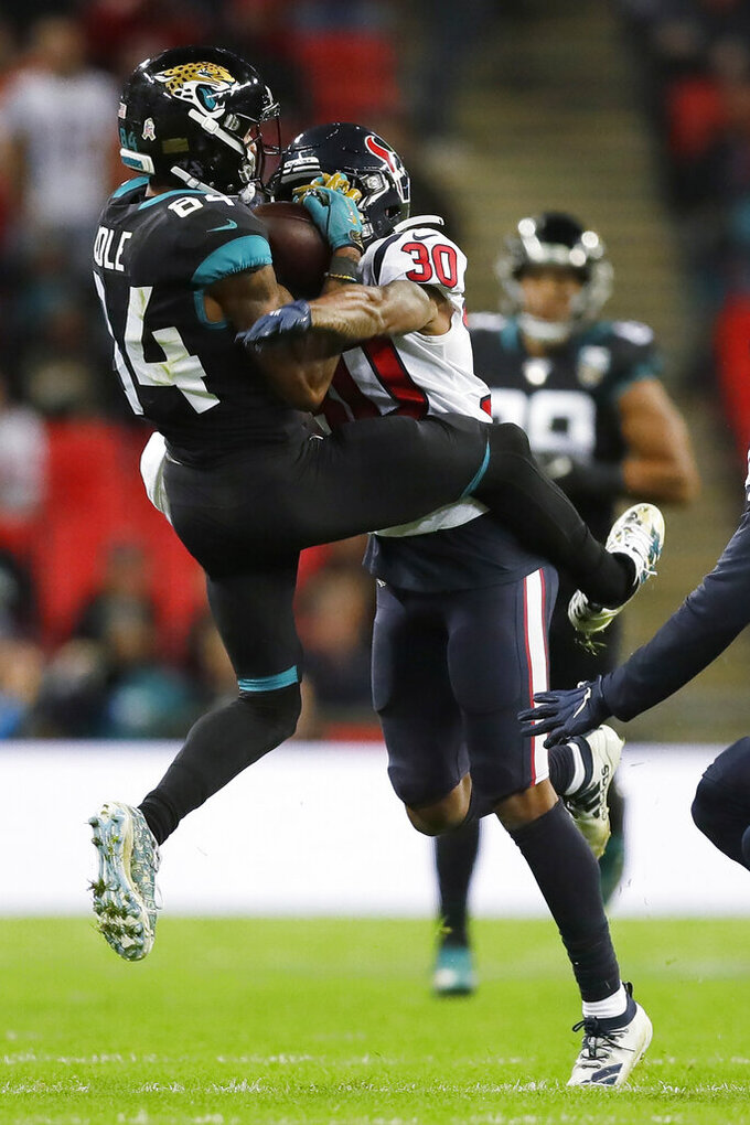 Jacksonville Jaguars wide receiver Keelan Cole (84) makes the catch against the Houston Texans during the second half of an NFL football game at Wembley Stadium, Sunday, Nov. 3, 2019, in London. (AP Photo/Kirsty Wigglesworth)