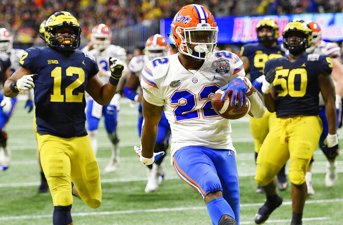 Florida running back Lamical Perine (22) runs into the end zone for a touchdown against Michigan during the first half of the Peach Bowl NCAA college football game, Saturday, Dec. 29, 2018, in Atlanta. (AP Photo/Mike Stewart)