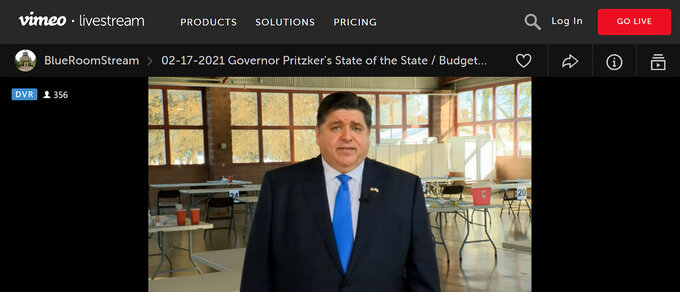 In this still image taken from video, Illinois Gov. J.B. Pritzker presents a remote version of his annual State of the State and budget addresses from a pavilion at the Illinois State Fairgrounds Wednesday, Feb. 17, 2021, in Springfield, Ill. Pritzker steeped in and often guided by Illinois history, chose the location to recall that it was an overflow field hospital in 1918 for victims of the Spanish Flu pandemic, and which, starting Wednesday, became one of the state's largest COVID-19 vaccination sites. (Advanced Digital Media via AP)