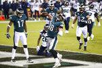 Philadelphia Eagles' Dallas Goedert (88) celebrates after scoring a touchdown during the first half of an NFL football game against the Seattle Seahawks, Monday, Nov. 30, 2020, in Philadelphia. (AP Photo/Derik Hamilton)