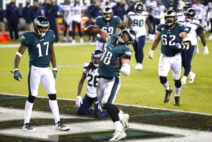 Philadelphia Eagles' Dallas Goedert (88) celebrates after scoring a touchdown during the first half of an NFL football game against the Seattle Seahawks, Monday, Nov. 30, 2020, in Philadelphia. (AP Photo/Derik Hamilton)