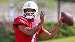 Miami Dolphins quarterback Tua Tagovailoa (1) throws during NFL football practice, Wednesday, Sept. 15, 2021, in Miami Gardens, Fla. The Dolphins host the Buffalo Bills on Sunday. (David Santiago/Miami Herald via AP)