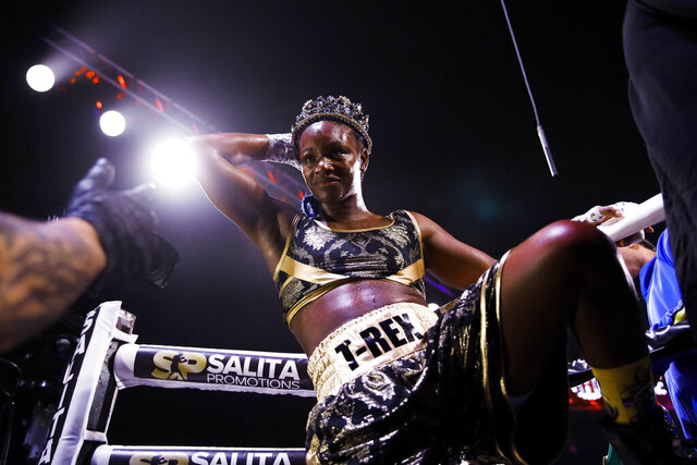 Claressa Shields climbs from the ring after defeating Ivana Habazin in their 154-pound title boxing bout in Atlantic City, N.J., Friday, Jan. 10, 2020. (AP Photo/Matt Rourke)