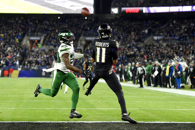 Baltimore Ravens wide receiver Seth Roberts (11) prepares to catch a touchdown pass from quarterback Lamar Jackson, not visible, as New York Jets free safety Marcus Maye (20) defends during the second half of an NFL football game, Thursday, Dec. 12, 2019, in Baltimore. (AP Photo/Gail Burton)