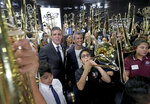 Fred Schiff, the owner of All County Music and Max Schachter, the father of Alex Schachter, stands with the recipients of the Alex Tribute Trombones on Saturday, May 11, 2019 in Tamarac, Fla. All County Music honored the life of Alex Schachter, a Marjory Stoneman Douglas shooting victim, by presenting $50,000 worth of specially designed Alex Tribute Trombones to 50 band students from 50 different south Florida schools. (Mike Stocker/South Florida Sun-Sentinel via AP)