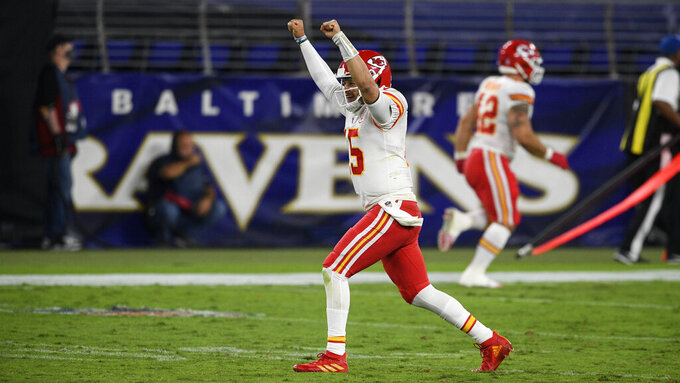 Kansas City Chiefs quarterback Patrick Mahomes celebrates his touchdown pass to offensive tackle Eric Fisher during the second half of an NFL football game against the Baltimore Ravens, Monday, Sept. 28, 2020, in Baltimore. In three previous meetings with Kansas City's Patrick Mahomes, the Patriots defense has had its most success when it's been able to force turnovers and get pressure on him. But that's easier said than done against a quarterback who has yet commit a turnover this season and is completing a career-high 68% of his passes. (AP Photo/Nick Wass, File)