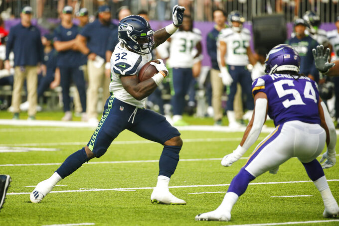 Seattle Seahawks running back Chris Carson (32) cuts away from Minnesota Vikings middle linebacker Eric Kendricks (54) in the first half of an NFL football game in Minneapolis, Sunday, Sept. 26, 2021. (AP Photo/Bruce Kluckhohn)