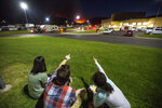 In this Thursday, Sept. 13, 2018, photo, residents watch a wildfire burning from outside Salem Hills High School in Salem, Utah. (Qiling Wang/The Deseret News via AP)