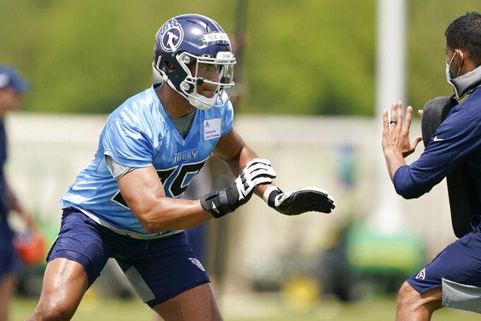 Tennessee Titans linebacker Rashad Weaver runs a drill during NFL football rookie minicamp Saturday, May 15, 2021, in Nashville, Tenn. (AP Photo/Mark Humphrey, Pool)