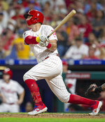 Philadelphia Phillies' Rhys Hoskins follows through on a double during the fourth inning of a baseball game against the Boston Red Sox, Saturday, Sept. 14, 2019, in Philadelphia. (AP Photo/Laurence Kesterson)