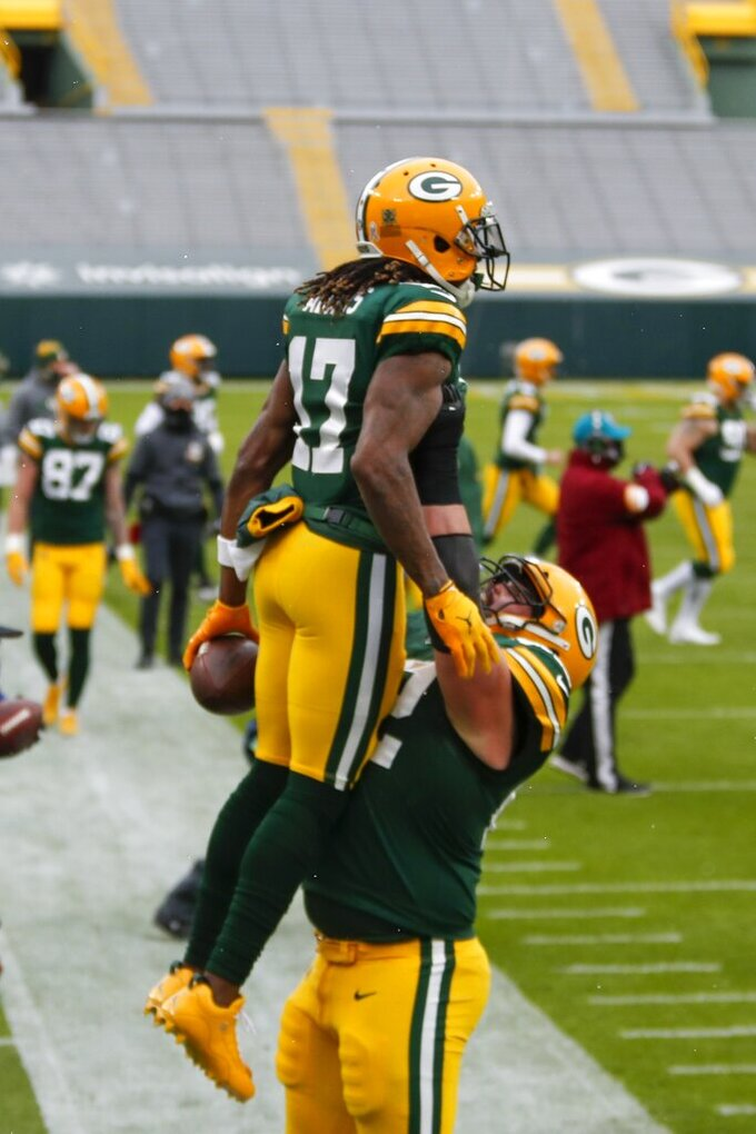 Green Bay Packers' Davante Adams is congrtaultaed by Lucas Patrick cafter catching a touchdown pass during the first half of an NFL football game against the Minnesota Vikings Sunday, Nov. 1, 2020, in Green Bay, Wis. (AP Photo/Matt Ludtke)