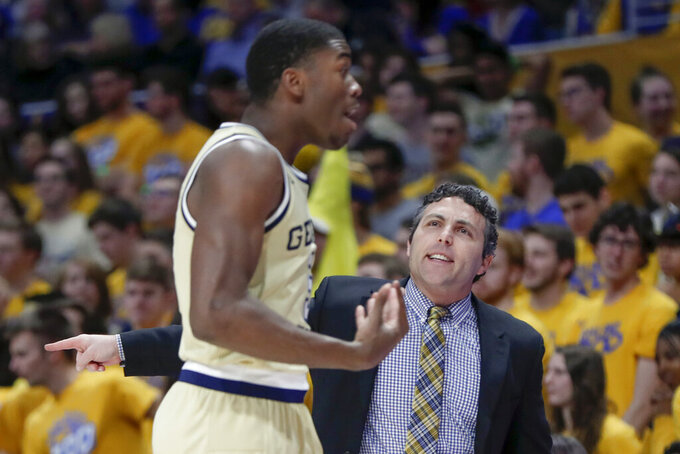 Georgia Tech's Moses Wright, left, reacts as head coach Josh Pastner talks to him during the first half of an NCAA college basketball game against Pittsburgh, Saturday, Feb. 8, 2020, in Pittsburgh. Pittsburgh won 73-64. (AP Photo/Keith Srakocic)