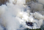 As the Greenwood Fire continues to burn, smoke from the blaze fills the air near Slater Lake and Highway 1 & 2 intersections as fire crews set back fires to better control the perimeter, Wednesday, Aug. 25, 2021, in Isabella, Minn. (Brian Peterson/Star Tribune via AP)