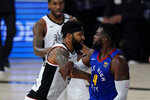 Los Angeles Clippers' Marcus Morris Sr., left, and Denver Nuggets' Paul Millsap scuffle during the first half of an NBA conference semifinal playoff basketball game, Friday, Sept. 11, 2020, in Lake Buena Vista, Fla. (AP Photo/Mark J. Terrill)