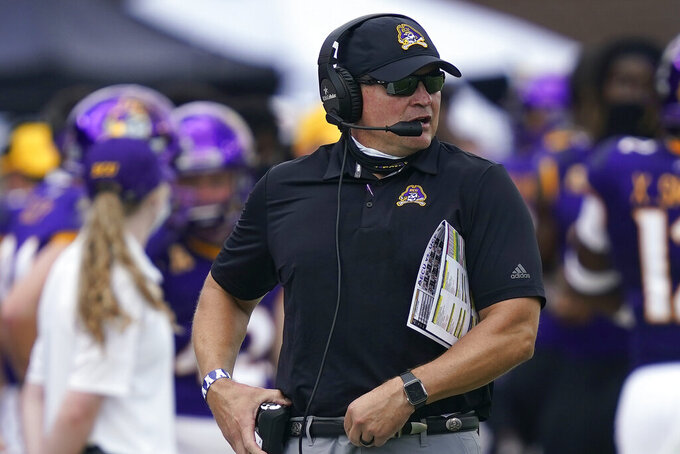 East Carolina head coach Mike Houston looks on during the first half of an NCAA college football game against Central Florida in Greenville, N.C., Saturday, Sept. 26, 2020. (AP Photo/Gerry Broome)