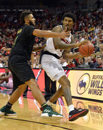 Louisville center Malik Williams (5) looks for help from the defense of Vermont forward Anthony Lamb (3) during the second half of an NCAA college basketball game in Louisville, Ky., Friday, Nov. 16, 2018. (AP Photo/Timothy D. Easley)