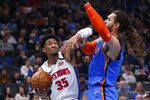 Detroit Pistons forward Christian Wood (35) drives to the basket in front of Oklahoma City Thunder center Steven Adams during the first half of an NBA basketball game Friday, Feb. 7, 2020, in Oklahoma City. (AP Photo/Sue Ogrocki)