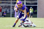 East Carolina's Tyler Snead (22) is taken down by South Carolina's Carlins Platel (21) during the second half of an NCAA college football game in Greenville, N.C., Saturday, Sept. 11, 2021. (AP Photo/Karl B DeBlaker)