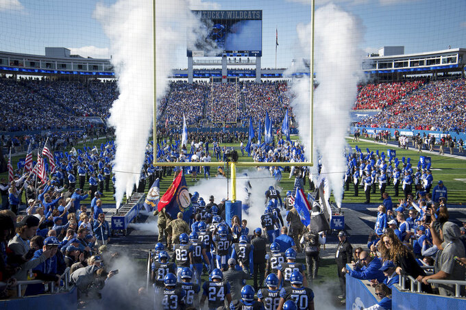 Kentucky takes the field before an NCAA college football game against Georgia in Lexington, Ky., Saturday, Nov. 3, 2018. (AP Photo/Bryan Woolston)