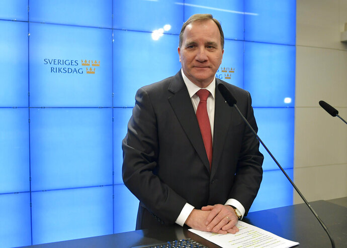 Social Democrat leader Stefan Lofven, attends a new briefing after being voted back as Prime Minister on Friday Jan. 18, 2019, ending a 131-day political deadlock.  Lofven passed Friday's vote after he secured the support of the Centre and Liberal parties, forming a government without the Sweden Democrats, which has neo-Nazi roots. (Jessica Gow / TT via AP)