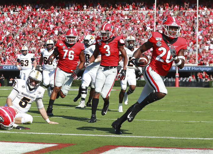 Georgia defensive back J.R. Reed scoops up a Murray State fumble and returns it for a touchdown during the first half of an NCAA college football game Saturday, Sept. 7, 2019, in Athens, Ga. (Curtis Compton/Atlanta Journal Constitution via AP)