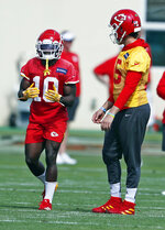 Kansas City Chiefs wide receiver Tyreek Hill (10) talks with quarterback Patrick Mahomes (15) during practice on Friday, Jan. 31, 2020, in Davie, Fla., for the NFL Super Bowl 54 football game. (AP Photo/Brynn Anderson)