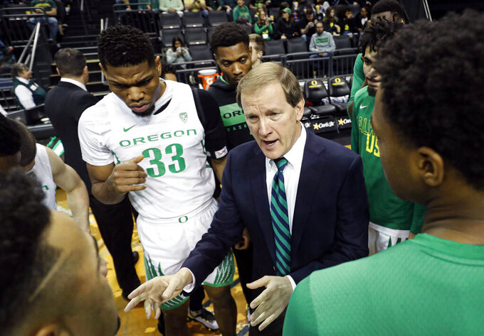 Oregon coach Dana Altman talks to his team before playing Alabama State in an NCAA college basketball game Sunday, Dec. 29, 2019, in Eugene, Ore. (AP Photo/Thomas Boyd)