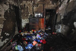 The burnt interior of a room is seen after a fire raced through the area on Wednesday night in Dhaka, Bangladesh, Friday, Feb. 22, 2019. Police on Friday were seeking up to a dozen suspects in connection with a fire in the oldest part of Bangladesh's capital that killed scores of people. (AP Photo/Mahmud Hossain Opu )