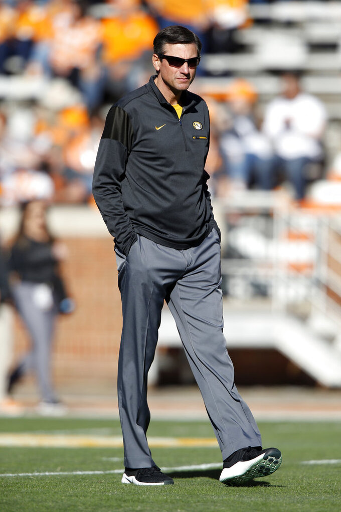 Former Tennessee head football coach and current Missouri offensive coordinator Derek Dooley walks the field before an NCAA college football game against Tennessee Saturday, Nov. 17, 2018, in Knoxville, Tenn. (AP Photo/Wade Payne)