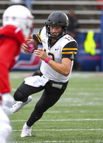 Appalachian State quarterback Zac Thomas (12) runs the ball against South Alabama during the second half of an NCAA college football game Saturday, Oct. 26, 2019, at Ladd-Peebles Stadium in Mobile, Ala. (AP Photo/Julie Bennett)